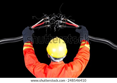 Electrician connecting power cable during work and electric spark - stock photo