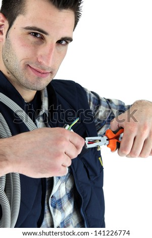electrician cutting a cable - stock photo