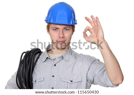 Electrician giving the ok sign - stock photo