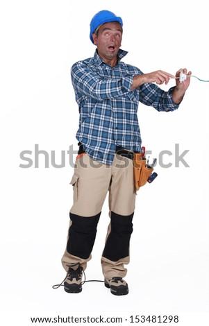 electrician having an electric shock - stock photo