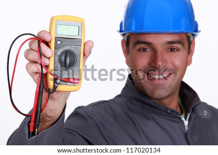 Electrician holding voltmeter - stock photo