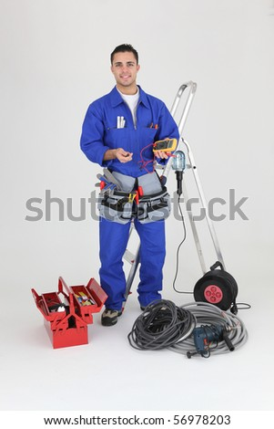 Electrician in overalls on white background
