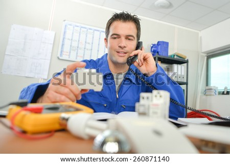 Electrician in the office - stock photo