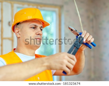 electrician installing electricity in a new house