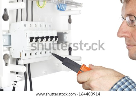 electrician is testing circuit with voltmeter, white background - stock photo