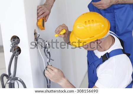electrician making wiring at new house