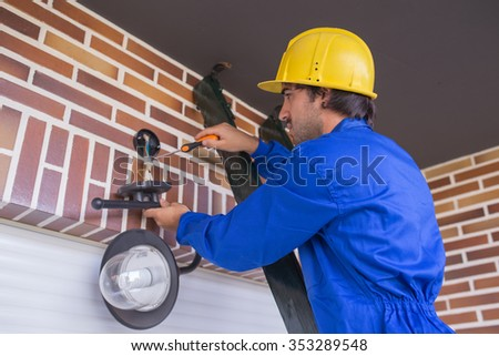electrician put lamppost - stock photo