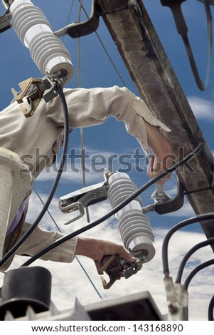 electrician repair the parts of high voltage transformer - stock photo