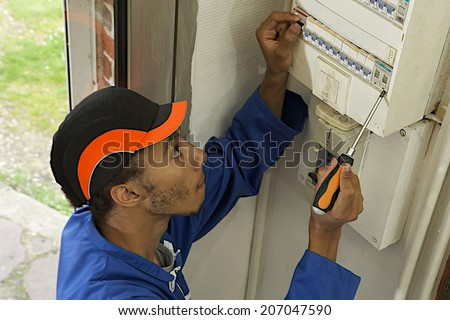electrician Repairing very old electricity switchboard  - stock photo