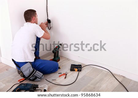 Electrician repairing wiring - stock photo