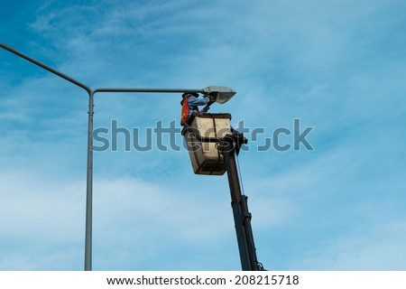 Electrician repairs on Power line - stock photo