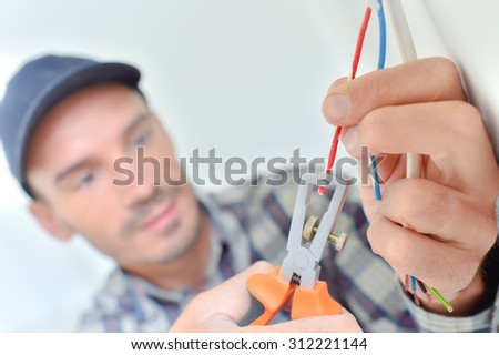 Electrician snipping a wire - stock photo