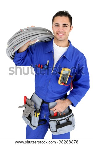 Electrician stood with cabling - stock photo