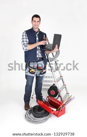 Electrician stood with his equipment - stock photo