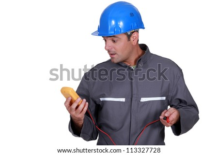 Electrician surprised by readings - stock photo