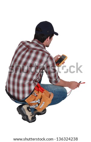 Electrician taking electrical reading - stock photo