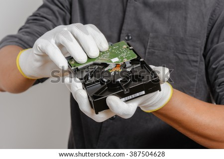 Electrician wear the antistatic gloves to protect an electrical components from damage. - stock photo
