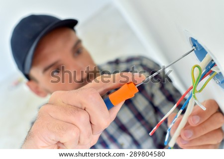 Electrician wiring a new build - stock photo