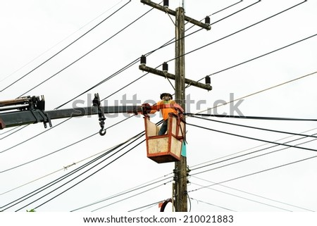Electrician Wiring Cable on Power line