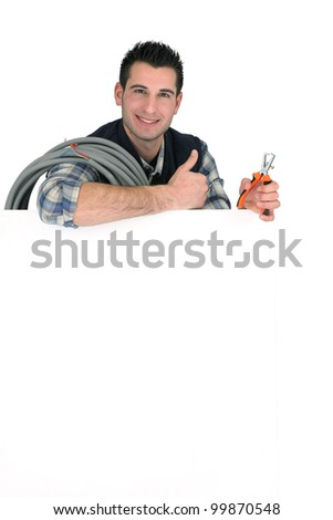 Electrician with a blank board - stock photo