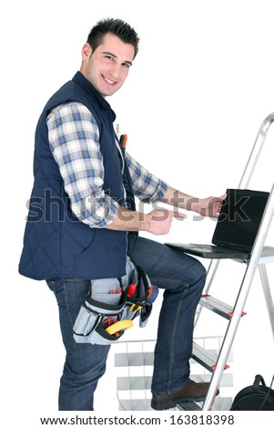 Electrician with a laptop - stock photo