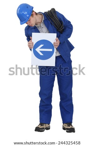 Electrician with a one way sign - stock photo