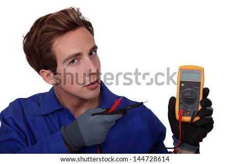 Electrician with meter reader - stock photo