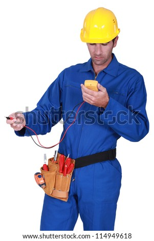 electrician with tester - stock photo