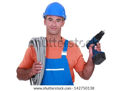 Electrician with wiring and cordless drill - stock photo