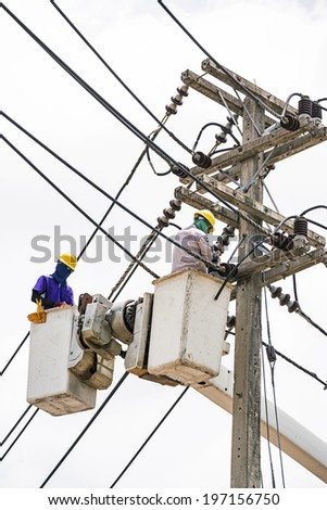 Electrician worker in a bucket, Electrical repairs to normal.  - stock photo