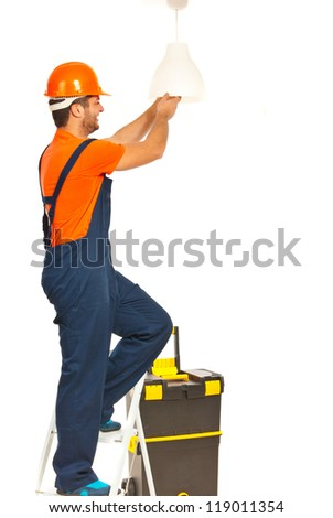 Electrician worker man working and changing a bulb isolated on white background - stock photo