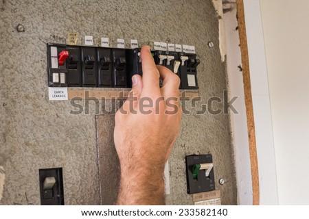 stock photo electrician working on the fuse box in the kitchen 233582140 home fuse box stock images, royalty free images & vectors switch box fuse connection 2006 lexus gs300 at mifinder.co