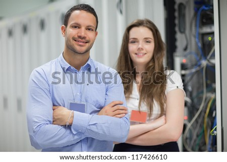 Electricians having arms crossed and standing in hallway - stock photo
