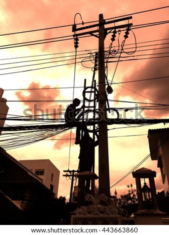 Electricians repairing wire of the power line - stock photo