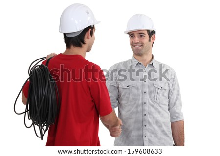 electricians shaking hands
