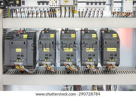 electricity distribution box with wires and circuit breakers (fuse box) - stock photo