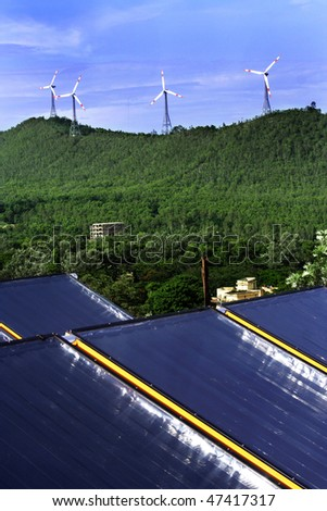 Electricity generation -Solar panels and wind turbines - stock photo