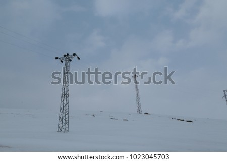electricity masts in the field