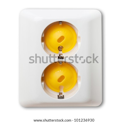 Electricity outlet on wall covered with safety plugs (baby and child safety concept)
