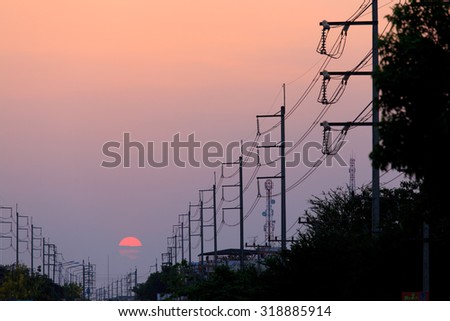 Electricity pole at sunset