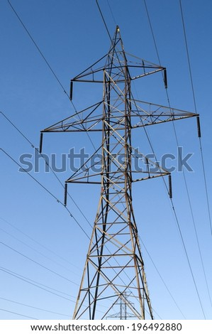 Electricity pole with numerous cables running through it. - stock photo