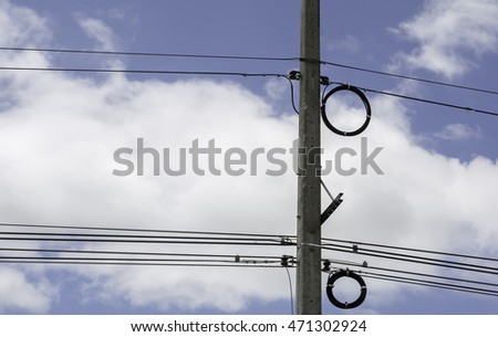 Electricity poles along the road in rural Thailand .