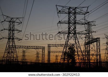Electricity poles at sunset in Soweto, a township of Johannesburg in South Africa.