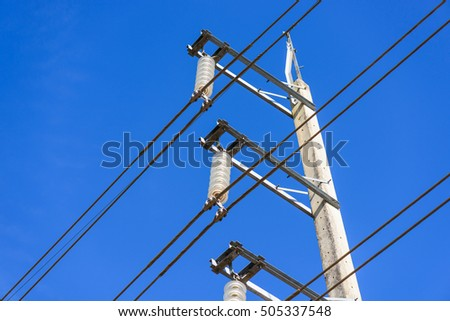 Electricity post against blue sky with cloud, electrical post by the road with power line cables