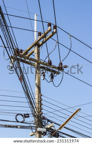 electricity post and illegal electricity connections - stock photo