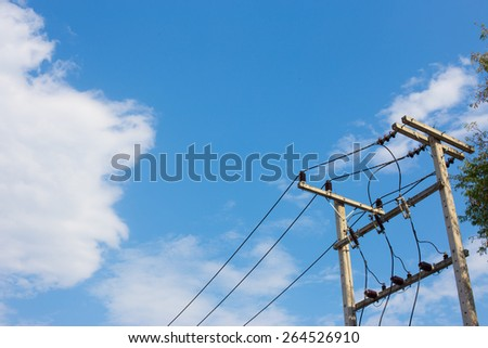 electricity post in blue sky at Thailand. - stock photo