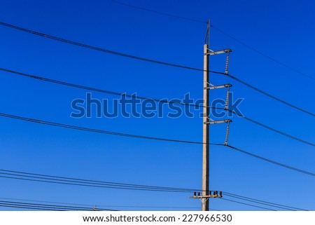 electricity post on blue sky background - stock photo