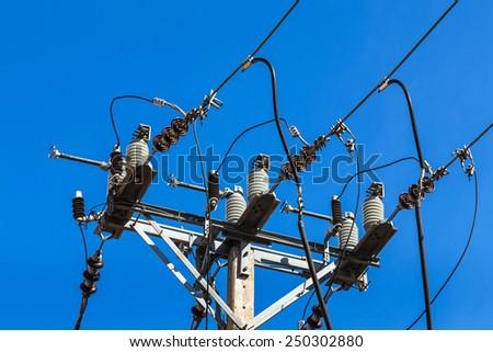 electricity post on blue sky background - stock photo