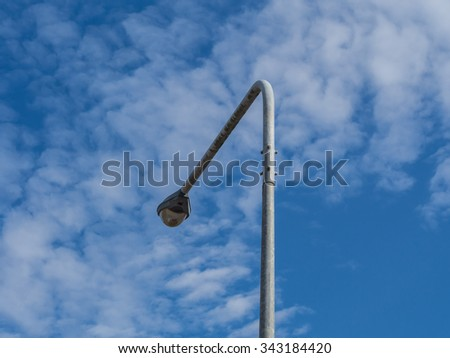 electricity post top with blue sky background