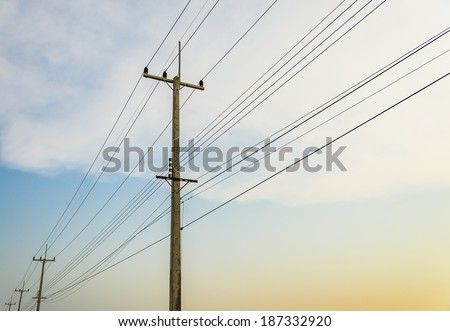Electricity post with blue sky - stock photo